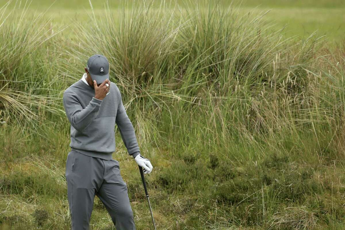 Tiger Woods prepares to take a shot from the rough on the fifth hole during the first round of the British Open on Thursday at the Old Course, St. Andrews, Scotland.