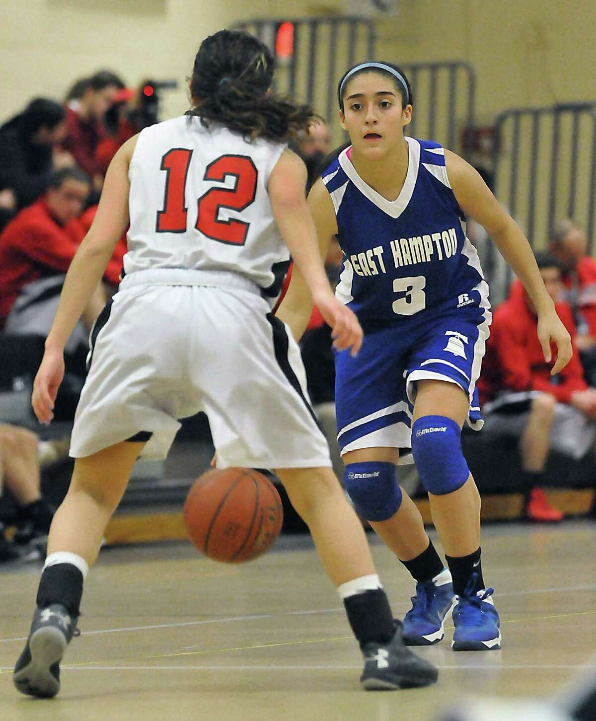 Catherine Avalone - The Middletown Press East Hampton freshman guard Gyanna Russell as Portland's Brittany Cote Tuesday evening in Portland. The East Hampton Bellringers defeated the Portland Panthers 43 - 34.