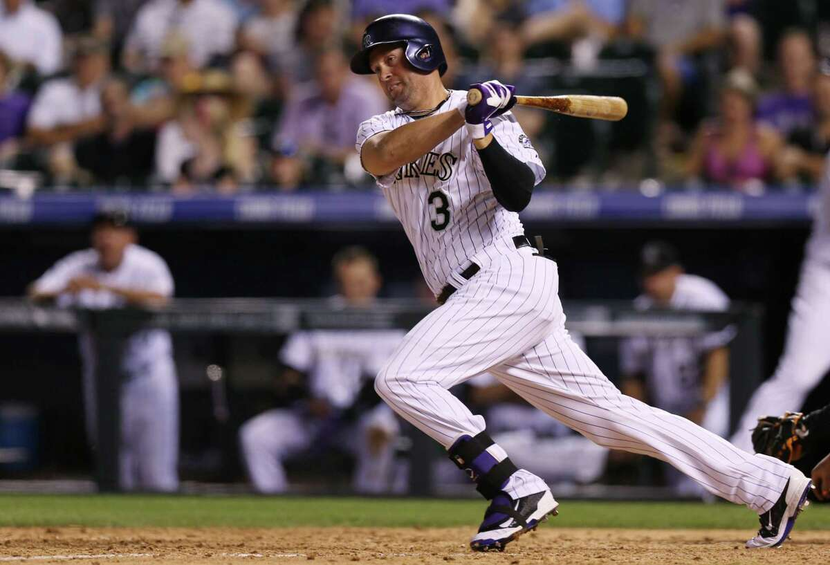 Michael Cuddyer became the first top free agent to switch teams since the season ended, leaving Colorado and joining the New York Mets on Monday for a $21-million, two-year contract.