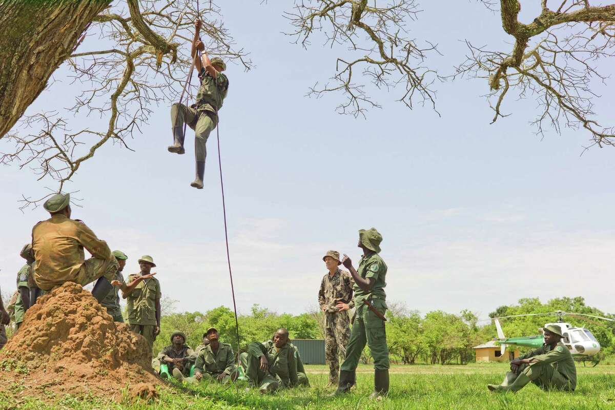 In this photo taken Dec. 29, 2014 and supplied by African Parks, the elite rapid response team members perform rope training to ascend and descend from a helicopter at the Garamba National Park, Congo. A shootout last month, in which three rangers and a Congolese army colonel were killed, highlighted the challenge of protecting parks in a part of Africa plagued for decades by insurgencies, civil war, refugee flows and weak governments.