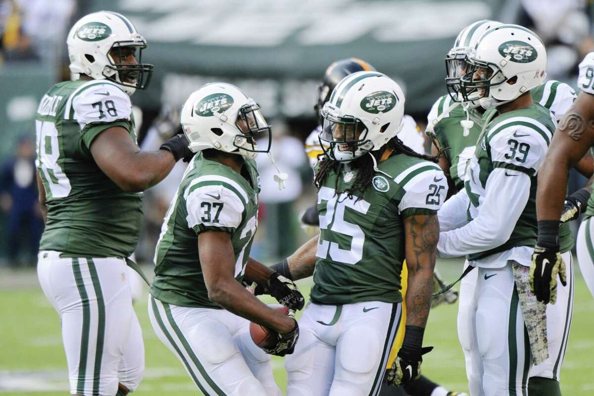 Jets free safety Jaiquawn Jarrett (37) and Calvin Pryor (25) celebrate a Jarrett interception during New York's win over Pittsburgh on Sunday in East Rutherford, N.J.