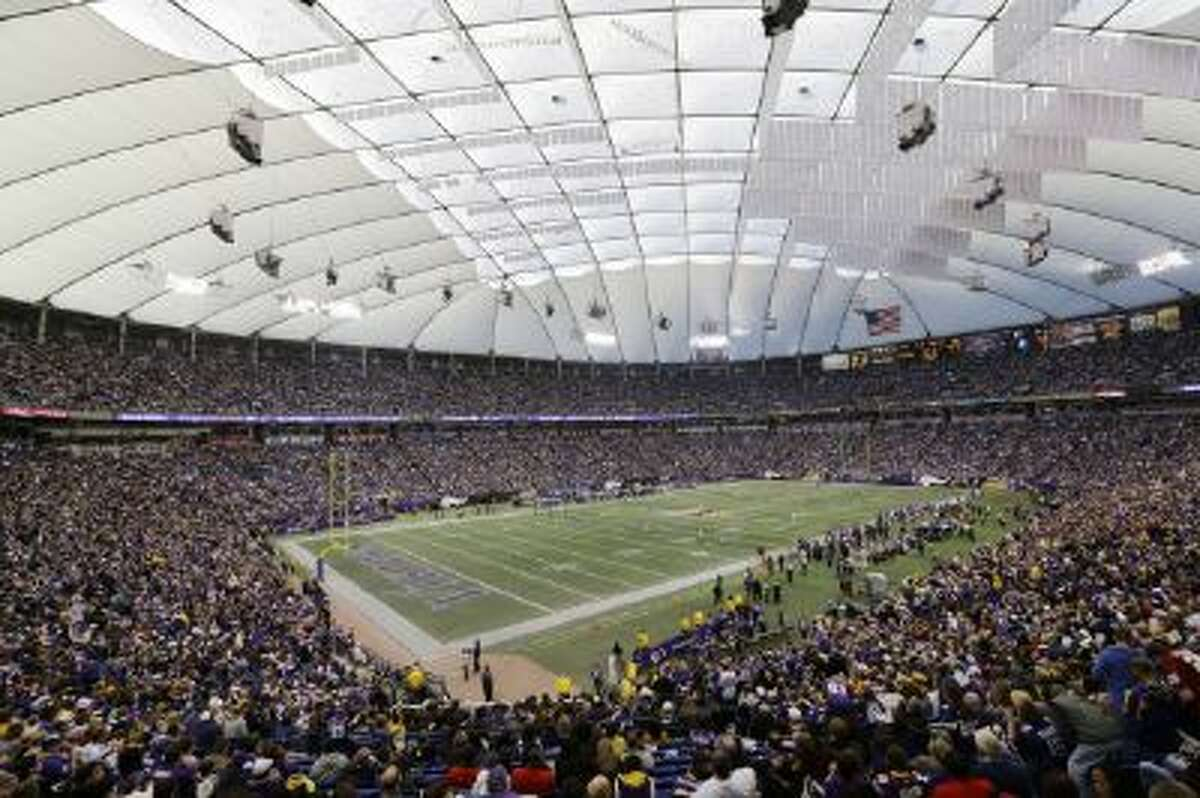Fans cheer during a football game between the Minnesota Vikings and the Detroit Lions at at the Hubert H. Humphrey Metrodome on Dec. 29, 2013.