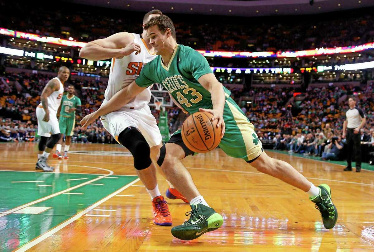 In this March 14, 2014 file photo, Boston Celtics forward Kris Humphries drives against the Phoenix Suns during a game in Boston. The Washington Wizards have acquired Humphries for a protected 2015 second-round draft pick.