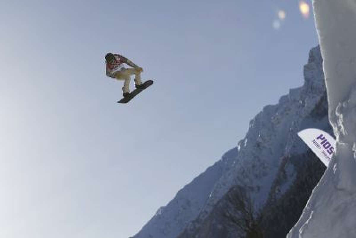Shaun White of the United States takes a jump during a Snowboard Slopestyle training session at the Rosa Khutor Extreme Park, prior to the 2014 Winter Olympics, Tuesday, Feb. 4, 2014, in Krasnaya Polyana, Russia.