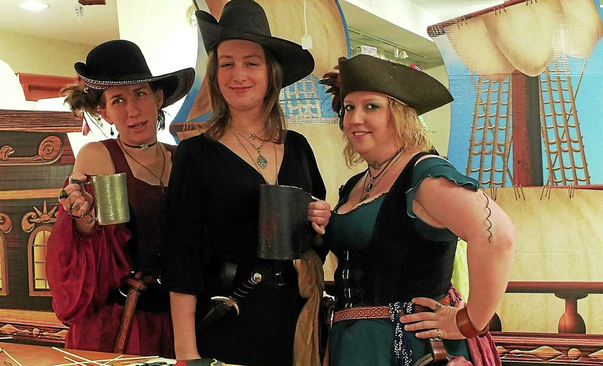 Contributed photo Pirate girls with tankards of grog are ready to party with the Sun Kings at the Connecticut River Museum in Essex. The Privateers' Bash will be held Saturday, March 14.