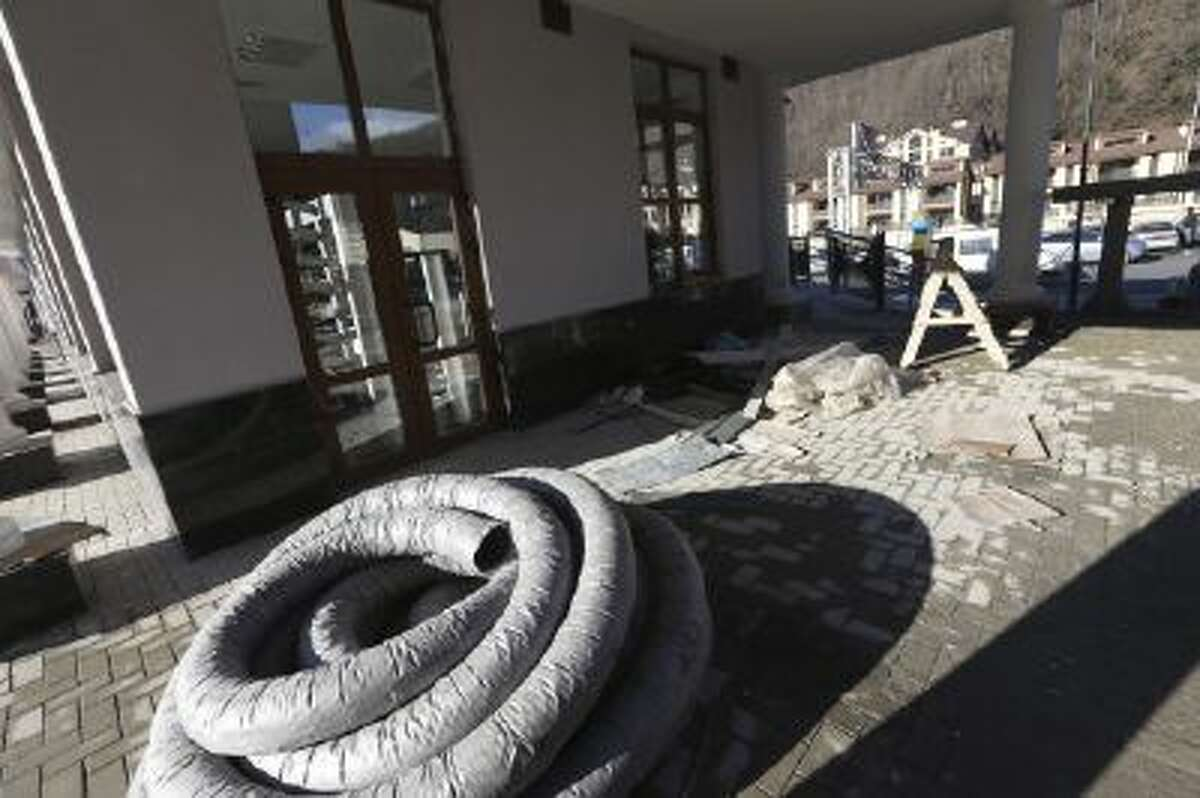 Building debris is left outside the Gorki Plaza East hotel in Krasnaya Polyana, Russia Sunday, Feb. 2, 2014. The IOC is urging Russian Olympic organizers to move quickly to resolve the issue of accommodations that are not ready for accredited media personnel in the mountains outside Sochi. According to the 2014 Sochi Winter Olympic organizing committee, only six of the nine media hotels in the mountain area are fully operational.