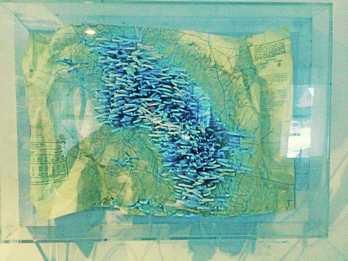 """""""Are We There Yet?"""" by Susan Chamberland, one of the works on display at the Essex Library."""