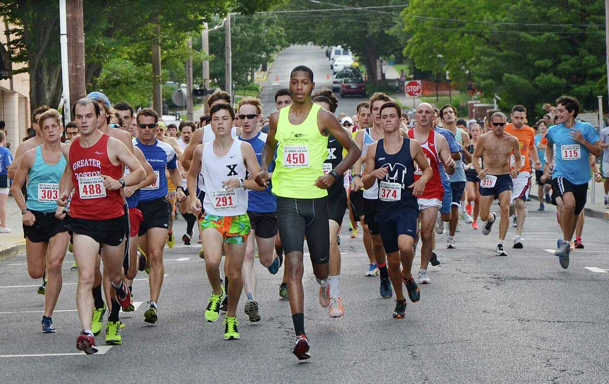 Middletown resident Rob Weston, wearing #450, leads the start of the Citizens Bank 5K Summer Fun Run on Court Street Street in Middletown last year.