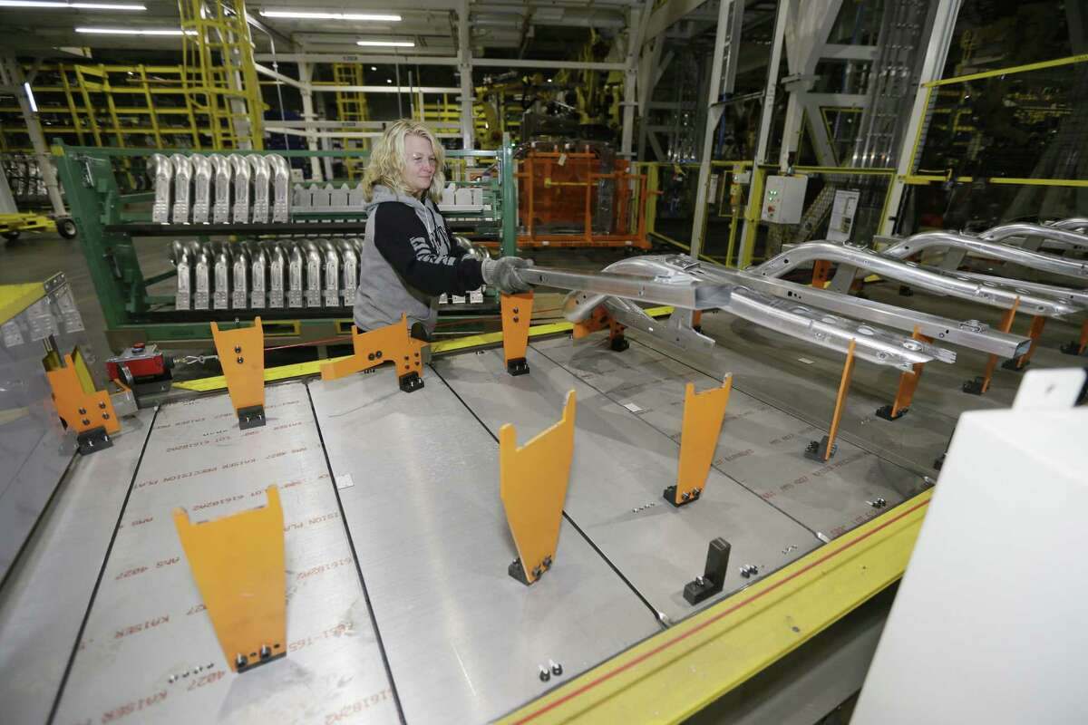 Jennifer Gillesbie works on the frame of the new Ford F-150 truck assembled at the Rouge Truck Plant in Dearborn, Mich.