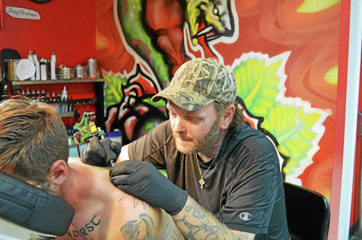 Tattoo Artist and part-owner of Goodspeed Tattoo George Smith of East Haddam tattoos Haddam resident Devin Fitzpatrick in his newly opened shop. Fitzpatrick, who has gotten several tattoos from Smith since 2006, was his first customer at Goodspeed Tattoo.