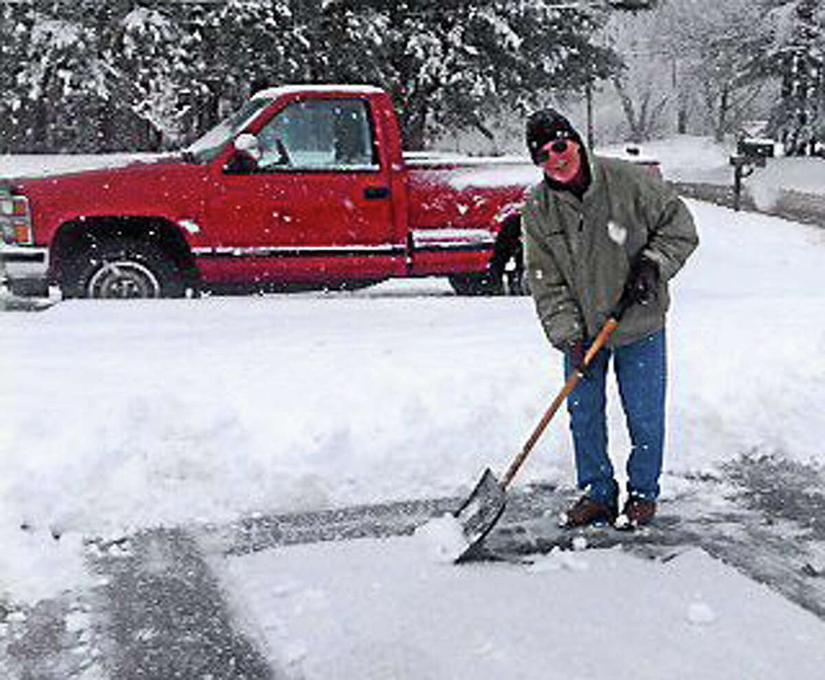 Submitted photo Australian Bob Crawshaw shovels snow in Middletown on Monday.