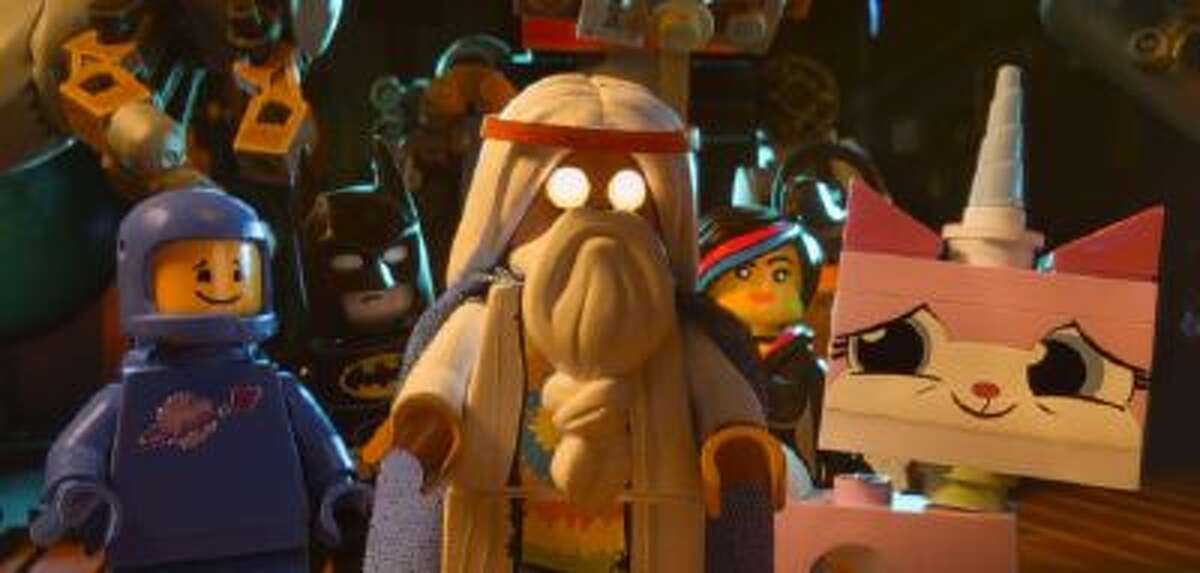 """This image released by Warner Bros. Pictures shows characters, from left, Benny, voiced by Charlie Day, Batman, voiced by Will Arnett, Vitruvius, voiced by Morgan Freeman, Wyldstyle, voiced by Elizabeth Banks and Unikitty, voiced by Alison Brie, in a scene from """"The Lego Movie."""""""