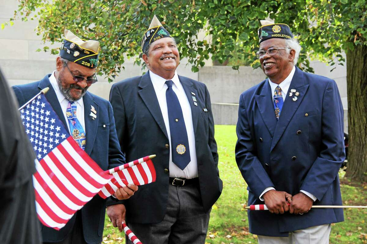 Veterans gather prior to the Veteran's Day ceremony on Tuesday in Middletown.