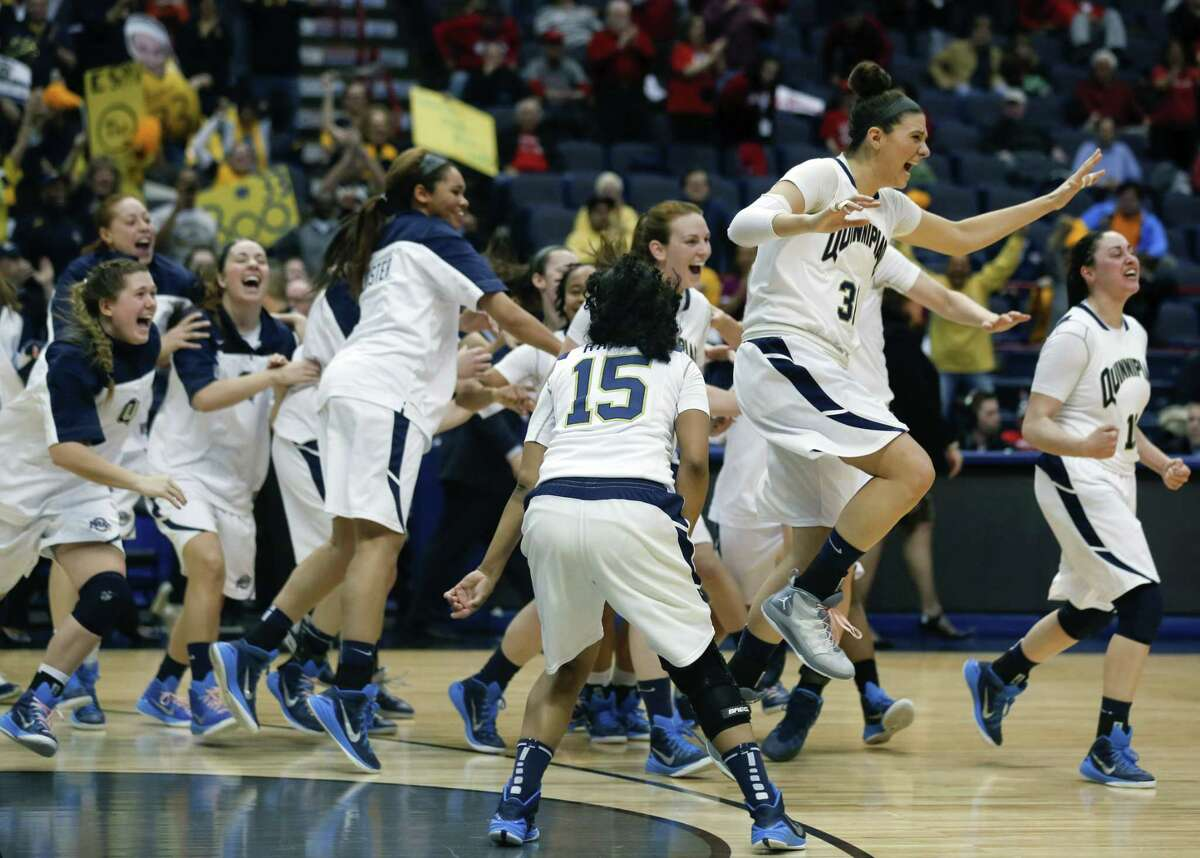 Quinnipiac players celebrate their 72-61 win over Marist in the MAAC tournament championship game Monday in Albany, N.Y.