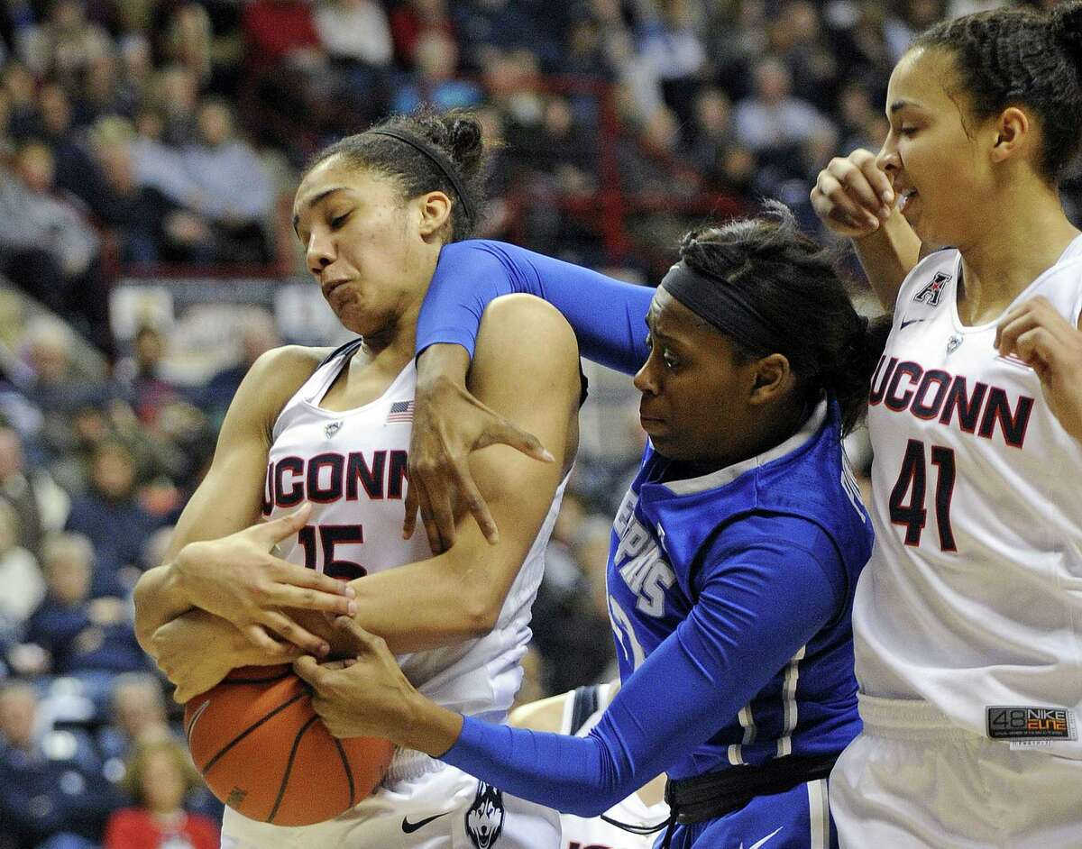 UConn's Gabby Williams (15) fights for a rebound with Memphis' Courtney Powell (32) as Kiah Stokes looks on during the Huskies' 87-24 victory on Feb. 28 in Storrs.