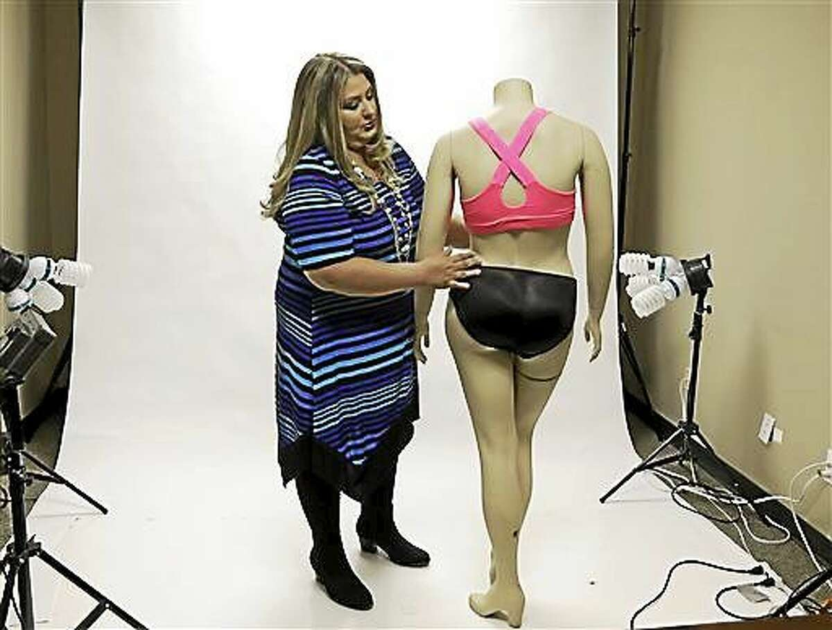 Jessica Asmar, owner of Feel Foxy, repositions a mannequin wearing a pair of padded panties Oct. 29 in the studio at her Katy, Texas warehouse. Asmar says 2014 has been its best year since launching nearly a decade ago. Sales are up 40 percent from a year ago.