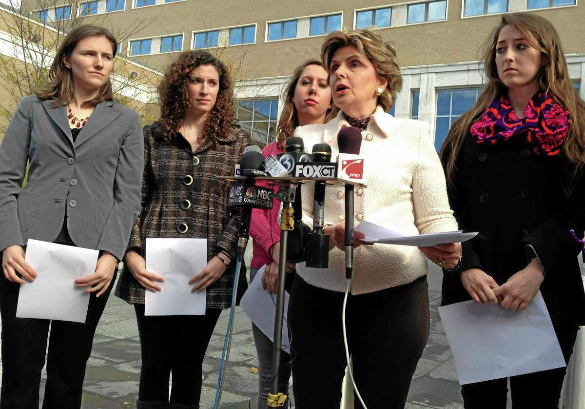 Attorney Gloria Allred, second from right, speaks to the media on Friday, Nov. 1, 2013 outside of U.S. District Court in Hartford, Conn. Allred filed a federal lawsuit on behalf of the four women with her, from left, Kylie Angell, Rosemary Richi, Erica Daniels and Carolyn Luby. UConn agreed to pay $1.3 million to settle the lawsuit in July 2014.