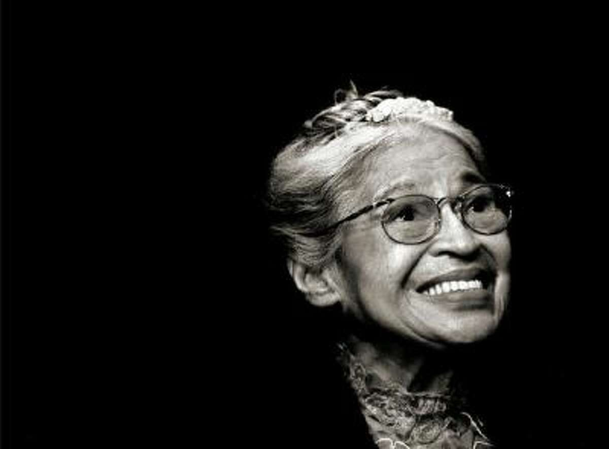 In this Nov. 28, 1999 photo, Rosa Parks smiles during a ceremony where she received the Congressional Medal of Freedom in Detroit. Parks, who lives in Detroit, is known for inspiring the modern civil rights movement by refusing to give up her bus seat to boarding whites, sparking the 1955 Montgomery bus boycott.