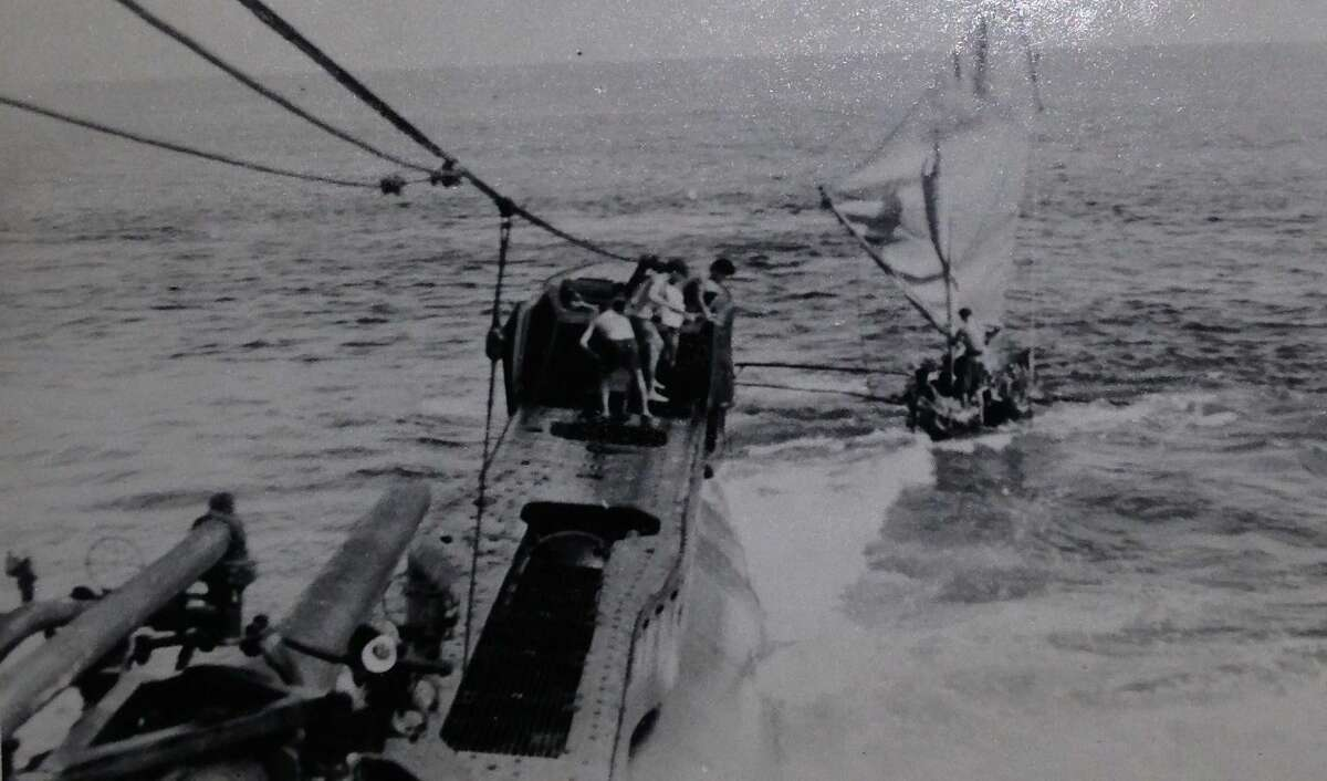 In this World War II 1945 photo, members of the combat swimmers and other operatives with the Office of Strategic Services conduct a Maritime Unit submarine-launched operation in the South Pacific to provide reconnaisance and demolition missions that allowed the Navy to land on key islands during the war.