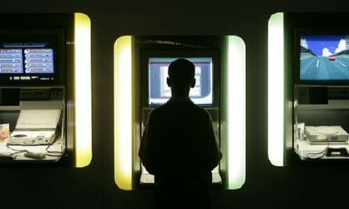 A boy plays on a video game at the Science Museum's 2006 exhibition of gaming hardware.