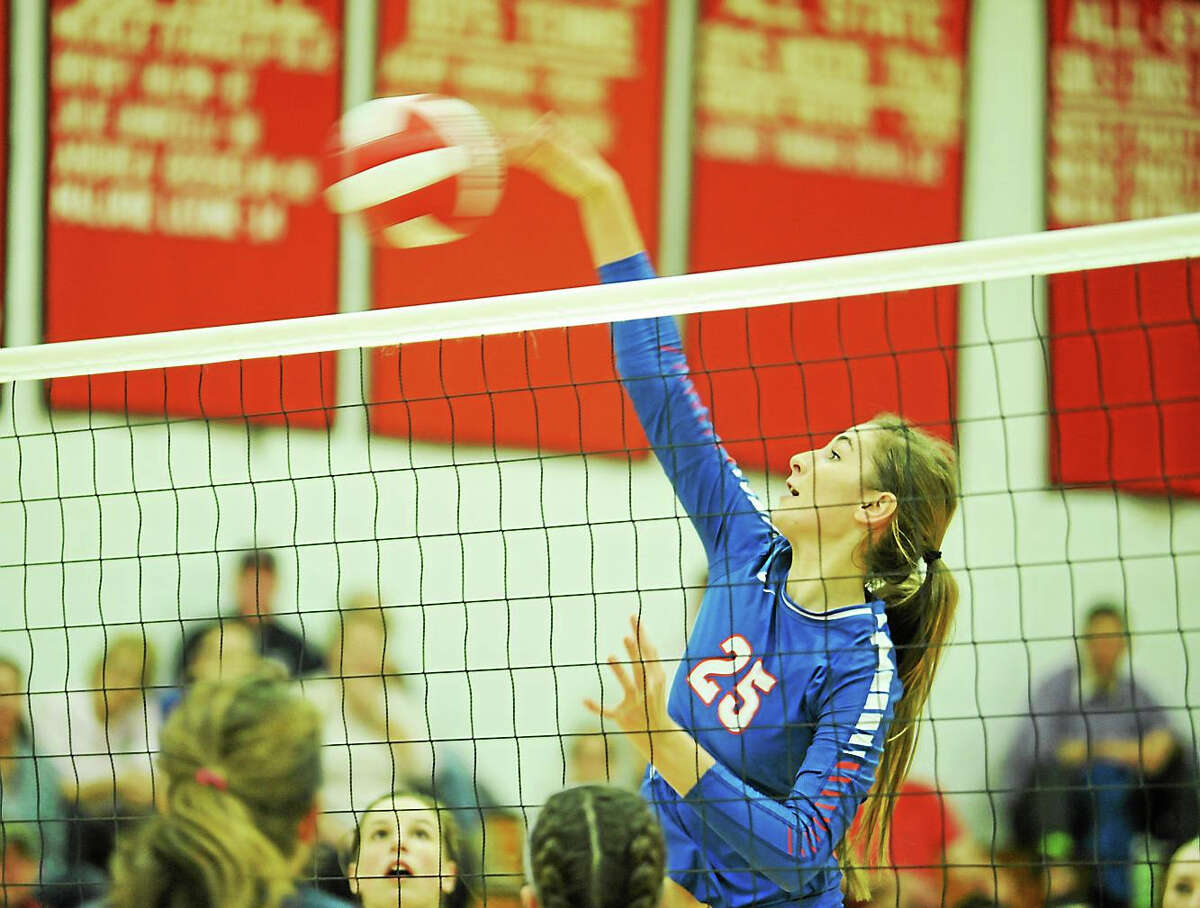 Hale-Ray senior hitter Andrea Wordell spikes the ball against Morgan. Wordell was selected the Shoreline Conference Player of the Year.