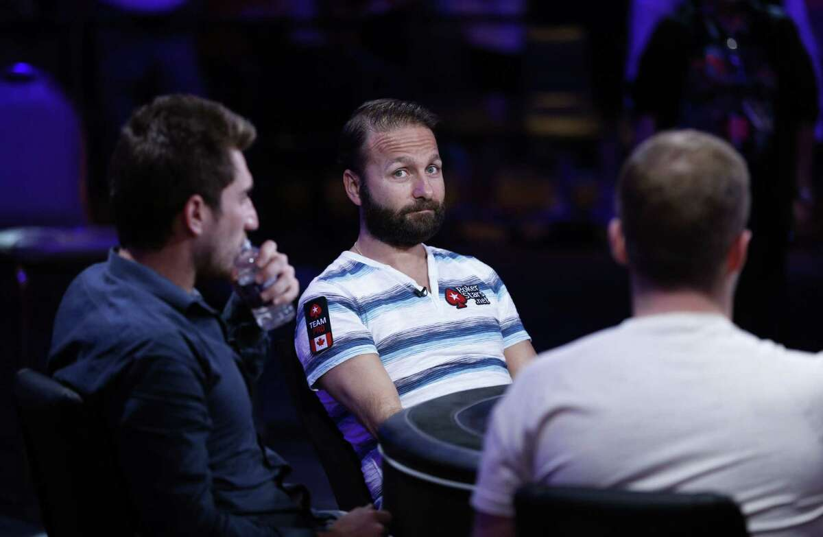 Daniel Negreanu, center, competes at the World Series of Poker main event on Tuesday in Las Vegas.
