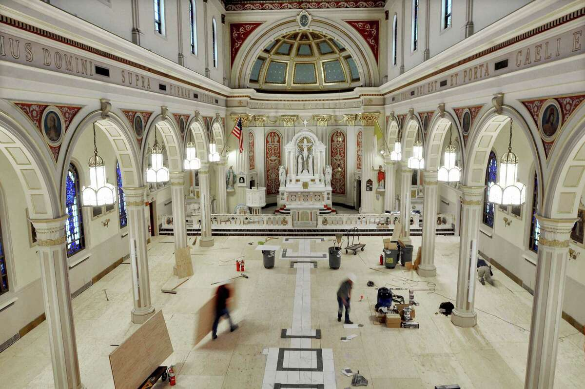Workers from C.F.M. Construction, of Glastonbury, the general contractor for the renovation of St. Sebastian Church replace the subflooring and will lay 5,000 square feet of Italian porcelain tile. One hundred new pews will be installed and the columns will be painted.