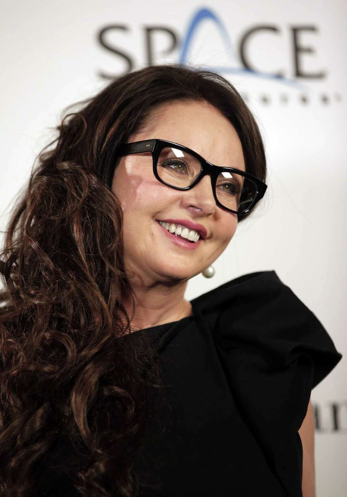 British singer Sarah Brightman poses for the photographers following a news conference, in central London, Tuesday, March 10, 2015. Brightman is scheduled to travel as a space tourist to the International Space Station on a trip scheduled for launch on Sept. 1, 2015. (AP Photo/Lefteris Pitarakis)