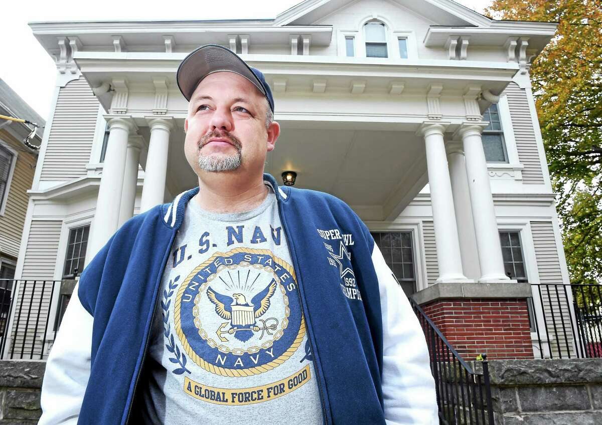 Veteran Richard Deso is photographed outside Harkness House in New Haven.