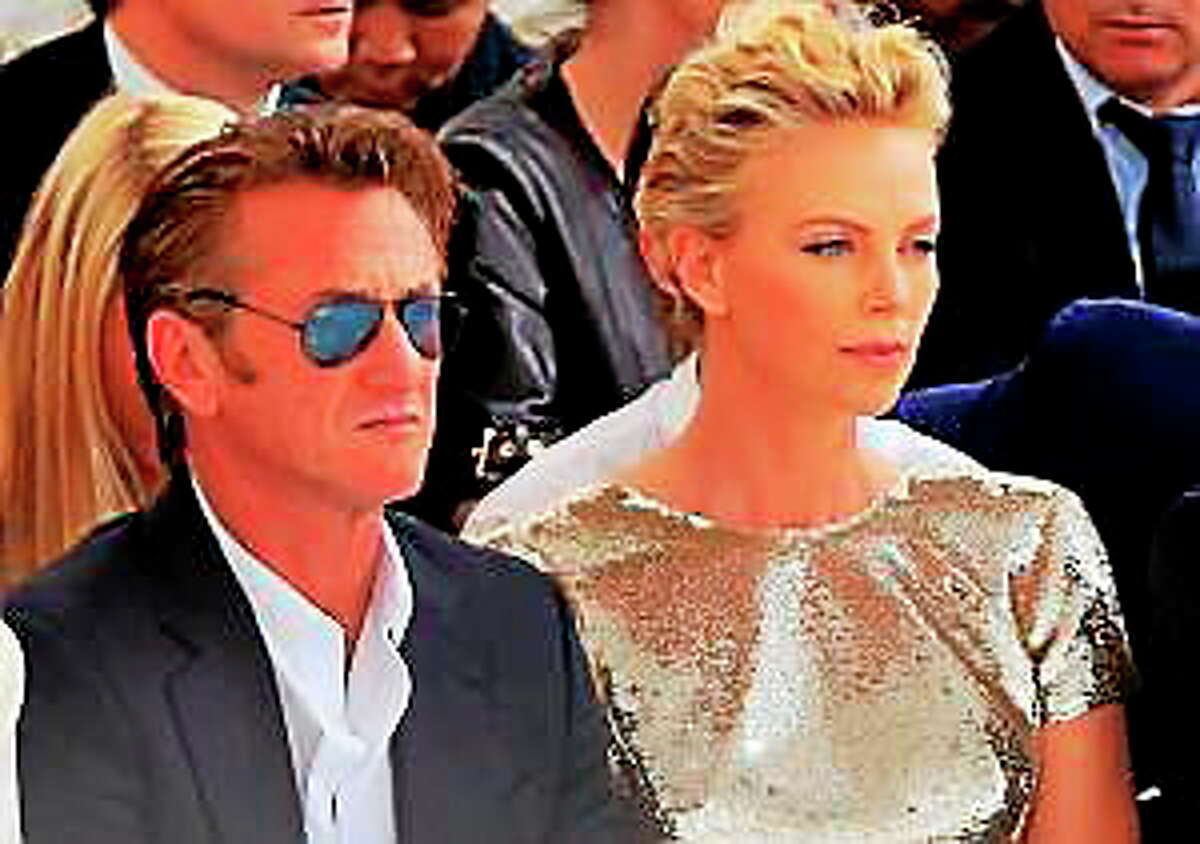 Actor Sean Penn and actress Charlize Theron attend Dior's Fall-Winter 2014-2015 Haute Couture fashion collection, in Paris, France, Monday, July 7, 2014.