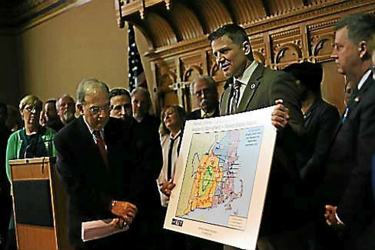 Sen. President Martin Looney, left, and Mohegan Chairman Kevin Brown show a drawing of the customer base for the new MGM Springfield casino.