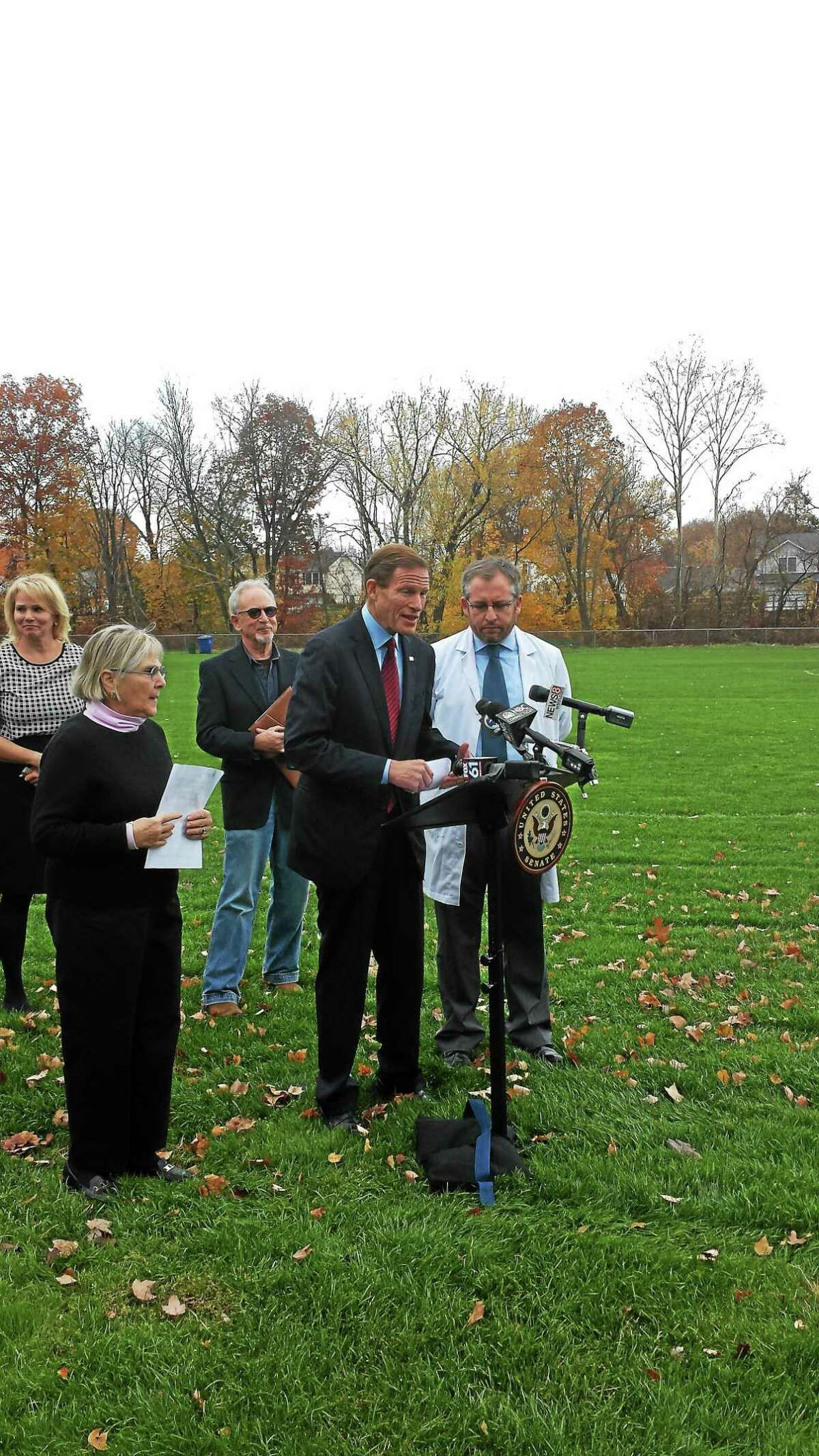 U.S. Sen. Richard Blumenthal , D-Conn., is joined by Nancy Alderman, left, of Environment and Health Inc. and Dr. Homero Horari of Mount Sinai Hospital in New York City to discuss concerns of crumb rubber pieces in synthetic turf fields Friday in West Hartford.