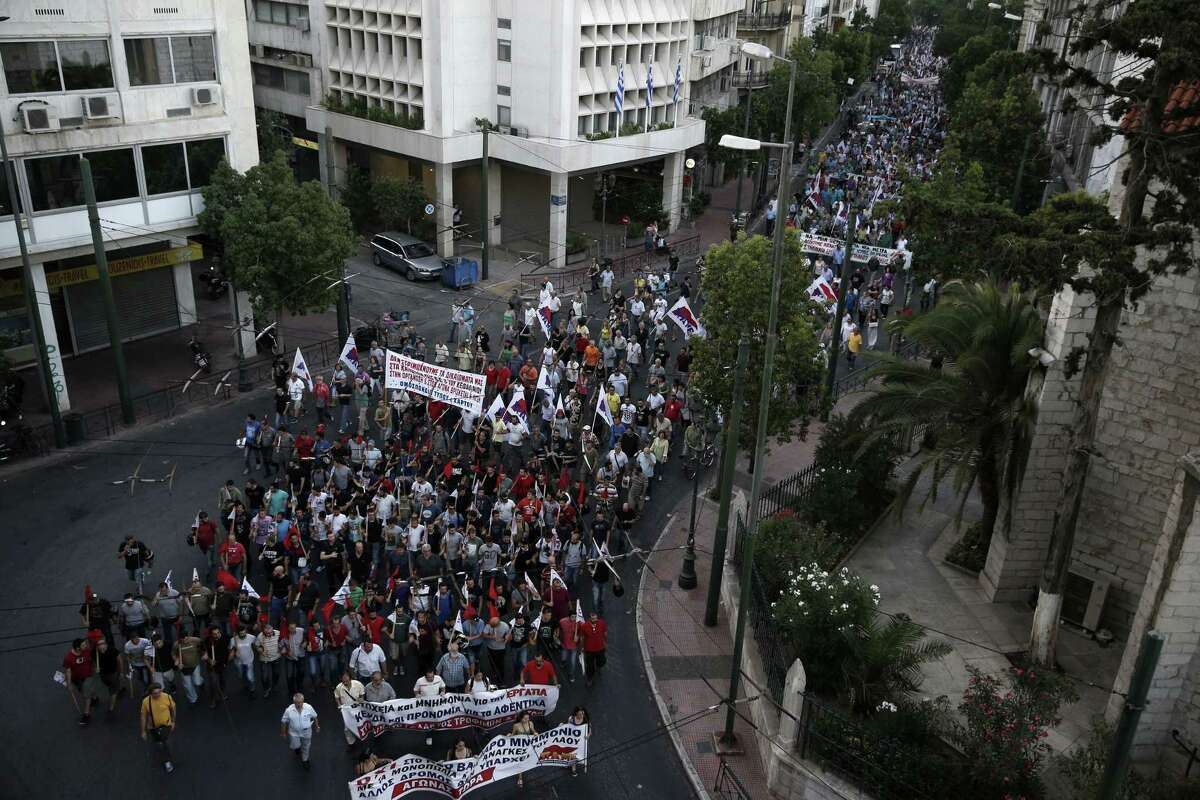 Members of the Communist-affiliated PAME labor union march during an anti-austerity rally in Athens Wednesday. Greece has a tentative rescue deal, but relief that it is not falling out of the euro is unlikely to last long: its economy has taken a huge hit.