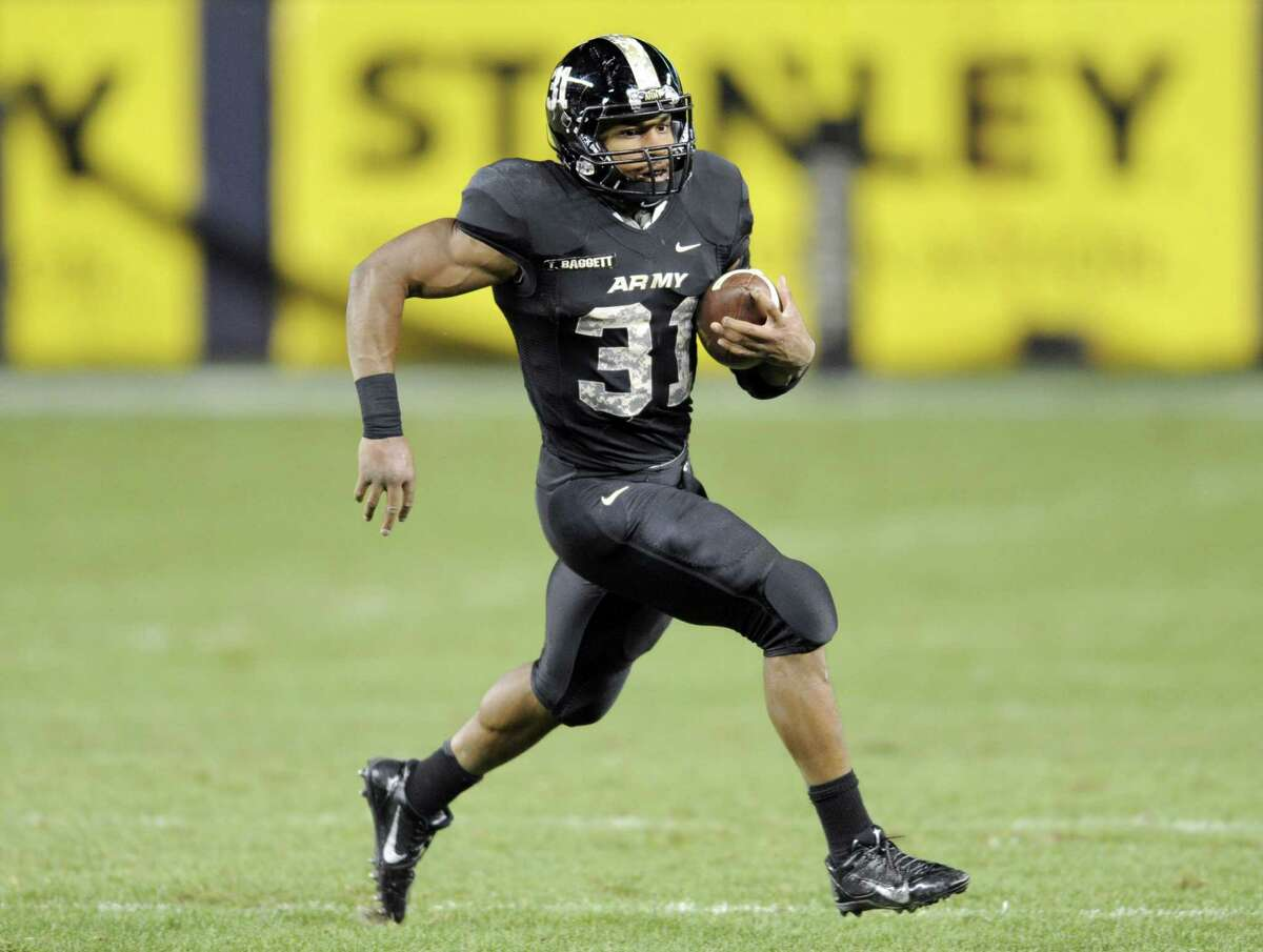 Army running back Terry Baggett runs with the ball during the second half of an NCAA college football game against Connecticut Saturday, Nov. 8, 2014, at Yankee Stadium in New York. Army won 35-21. (AP Photo/Bill Kostroun)