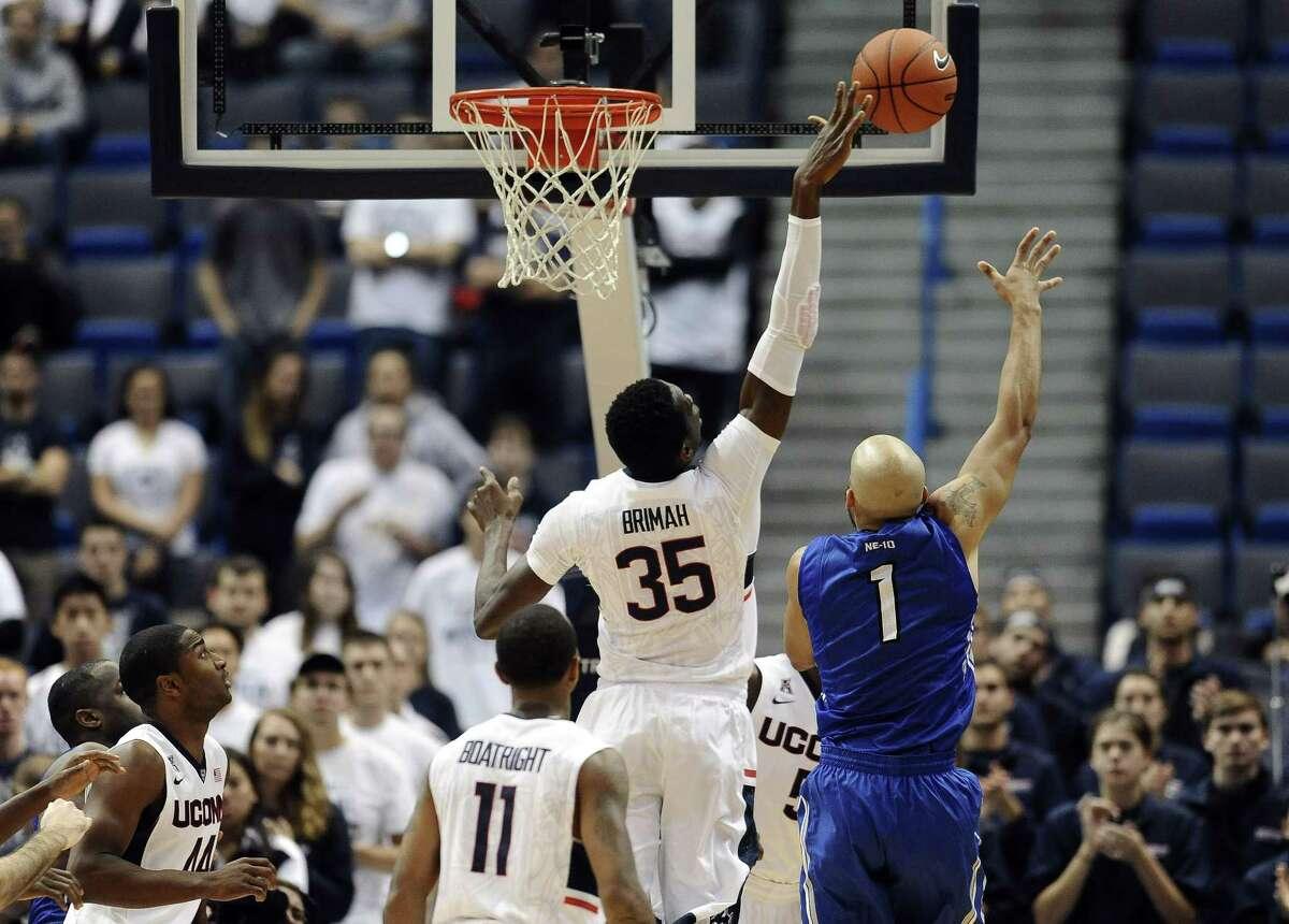 Connecticutís Amida Brimah (35) blocks a shot-attempt by Assumptionís Terrance Bobb-Jones (1) during the second half of an NCAA college basketball game, Sunday, Nov. 9, 2014, in Hartford, Conn. (AP Photo/Jessica Hill)