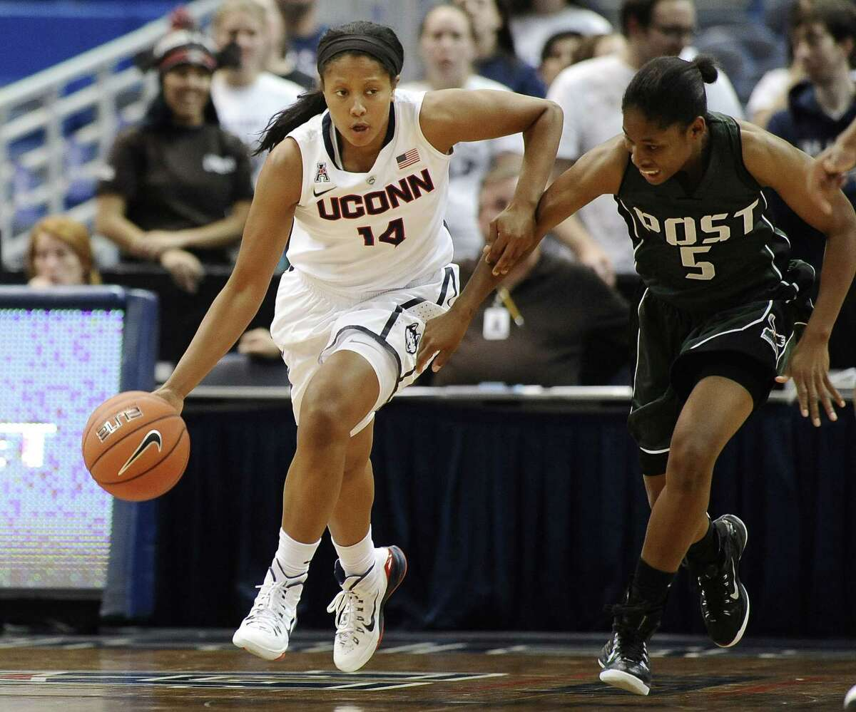 Connecticutís Sadie Edwards, left, is guarded by C.W. Postís Essence Casey, right, during the second half of an NCAA women's college basketball game, Sunday, Nov. 9, 2014, in Hartford, Conn. Connecticut won (AP Photo/Jessica Hill)