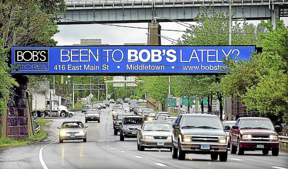 The Bob's Stores advertisement on the Railroad Bridge above the southbound lane of Route 9 is shown in this 2007 photo. Bob's has since moved to East Main Street in the Stop & Shop plaza. The state just granted $500,000 to remediate its former location on 339 Main Street in Middletown. Photo: File