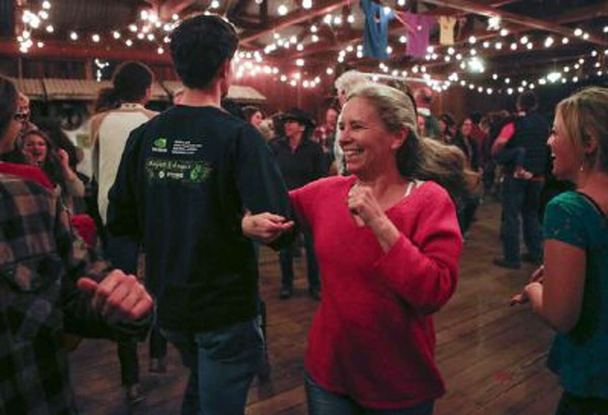 Sally Lansdale, of Santa Cruz, dances at the barn dance at Pie Ranch in Pescadero, Calif., on Saturday, Jan. 18, 2014.