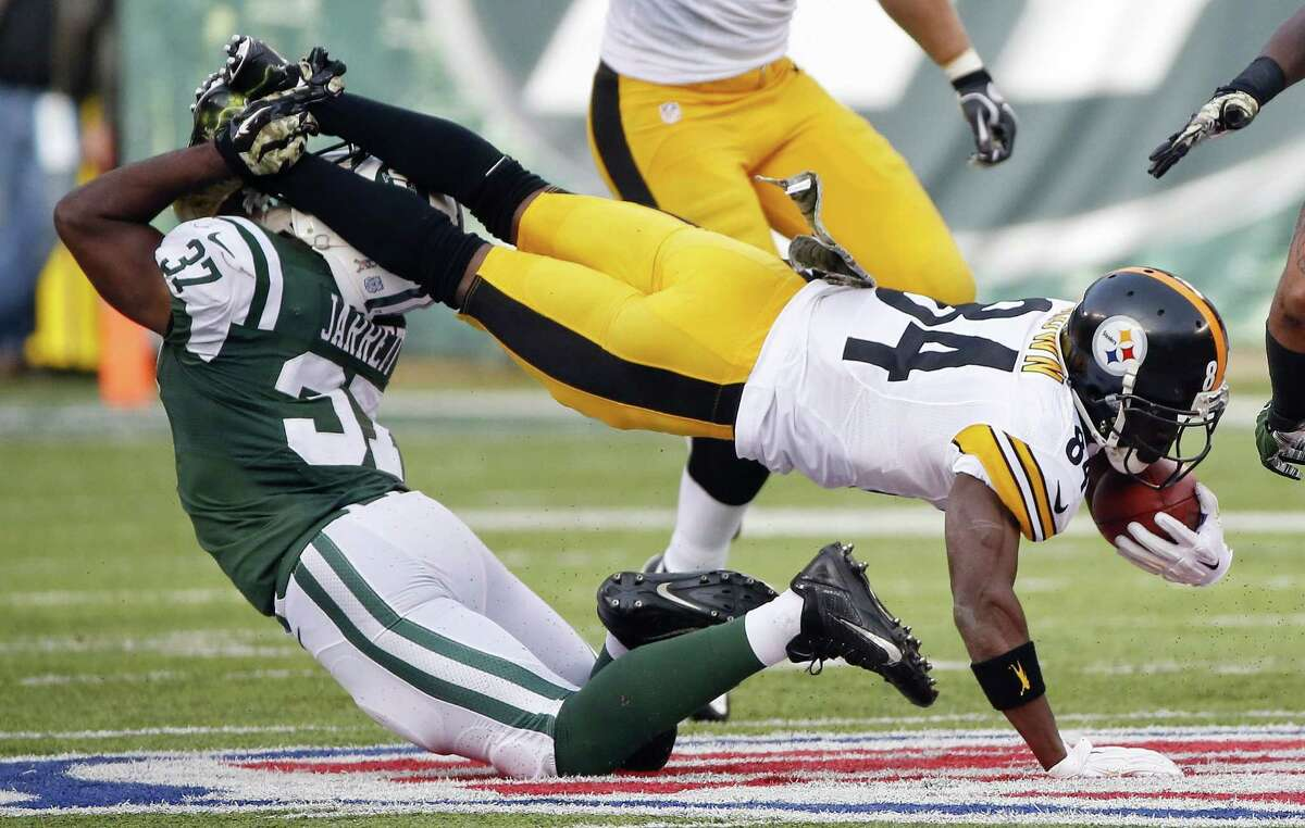 New York Jets free safety Jaiquawn Jarrett (37) tackles Pittsburgh Steelers' Antonio Brown (84) during the first half of an NFL football game Sunday, Nov. 9, 2014, in East Rutherford, N.J. (AP Photo/Kathy Willens)