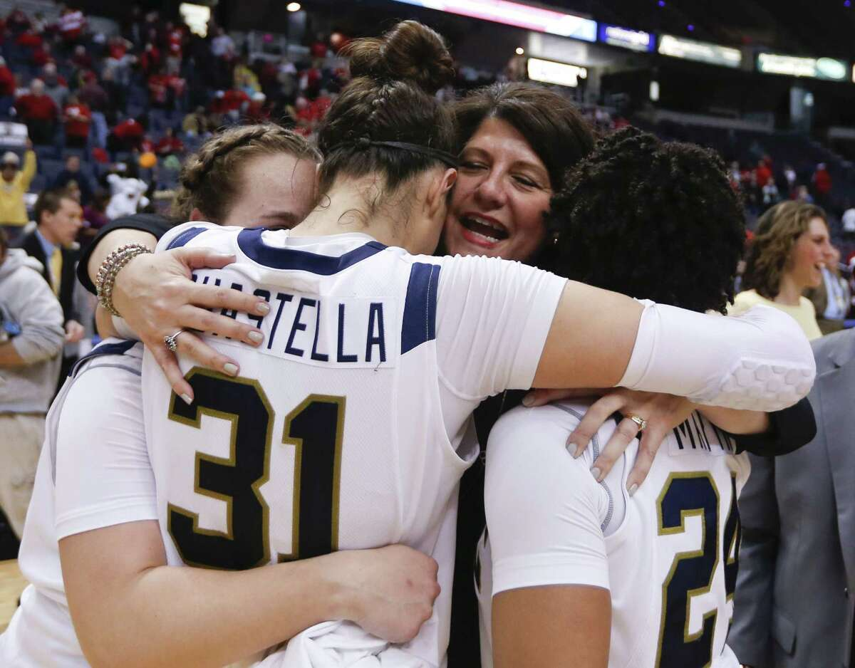 Quinnipiac head coach Tricia Fabbri hugs Gillian Abshire, Sam Guastella and Jasmine Martin after the Bobcats' 72-61 win over Marist in the MAAC tournament championship game on Monday in Albany, N.Y.