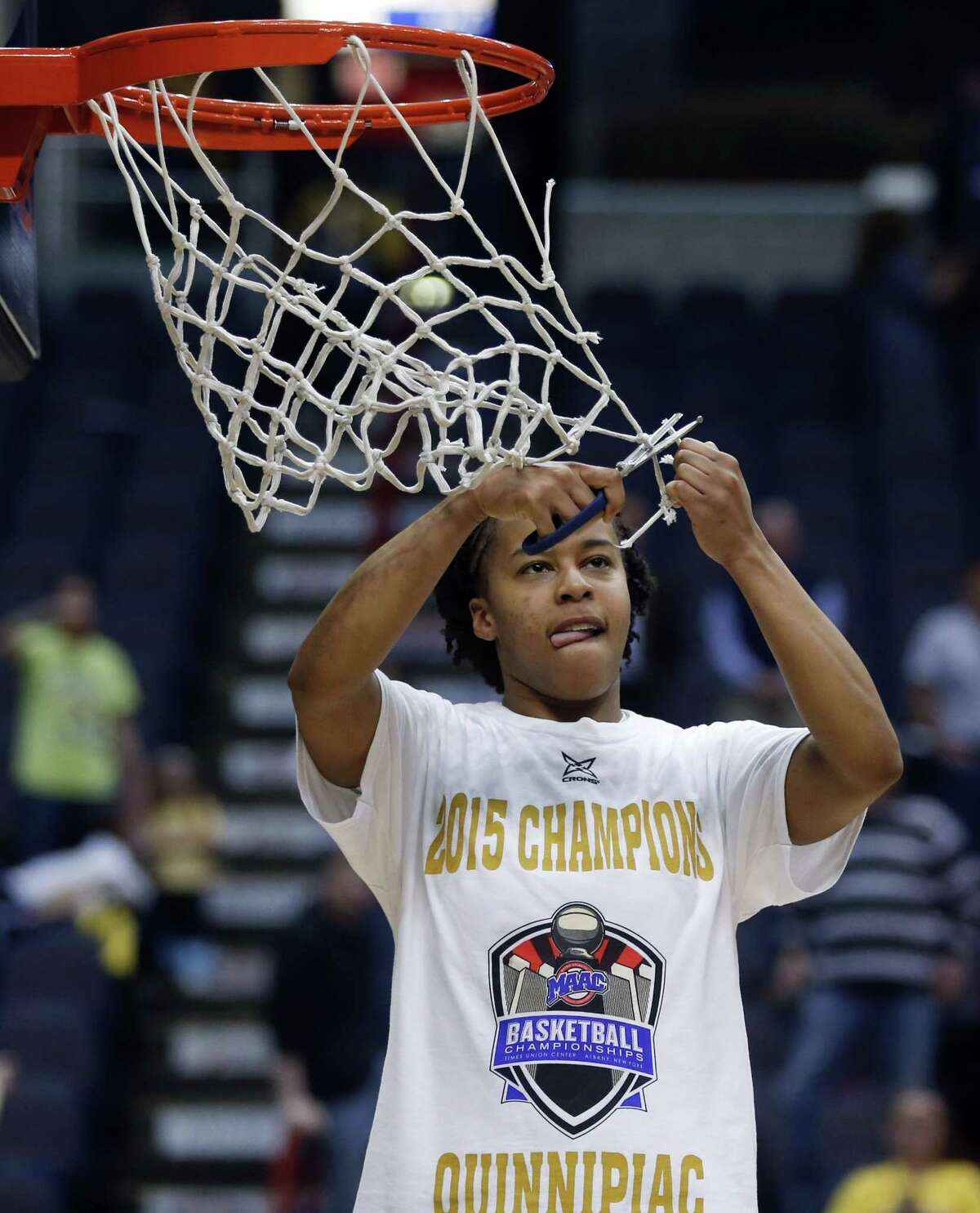Quinnipiac's Jasmine Martin cuts the net after the Bobcats' 72-61 win over Marist in the MAAC tournament championship game on Monday in Albany, N.Y.