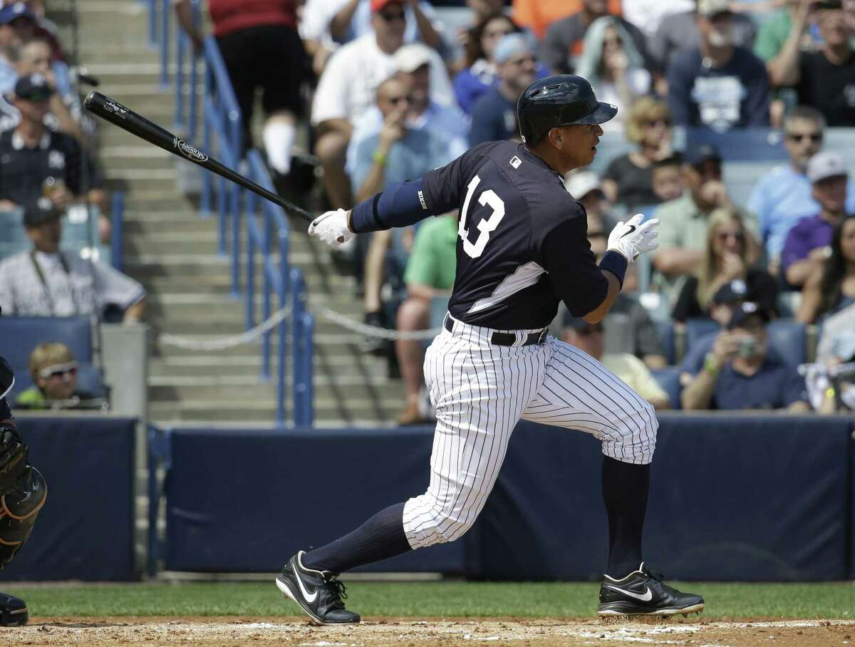 New York Yankees third baseman Alex Rodriguez follows through on a RBI single to score Brian McCann in the second inning of Monday's game against the Tampa Bay Rays in Tampa, Fla.