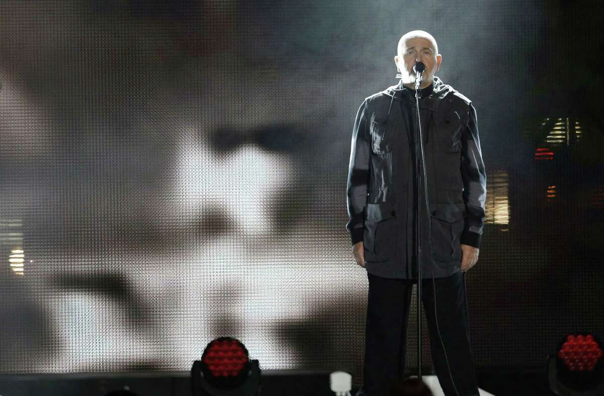 British singer Peter Gabriel performs the song 'Heroes' in front of the Brandenburg Gate in Berlin, Germany on Nov. 9, 2014. Twenty-five years ago - on Nov. 9, 1989 - the East-German government lifted travel restrictions and thousands of East Berliners had pushed their way past perplexed border guards to celebrate freedom with their brethren in the West.