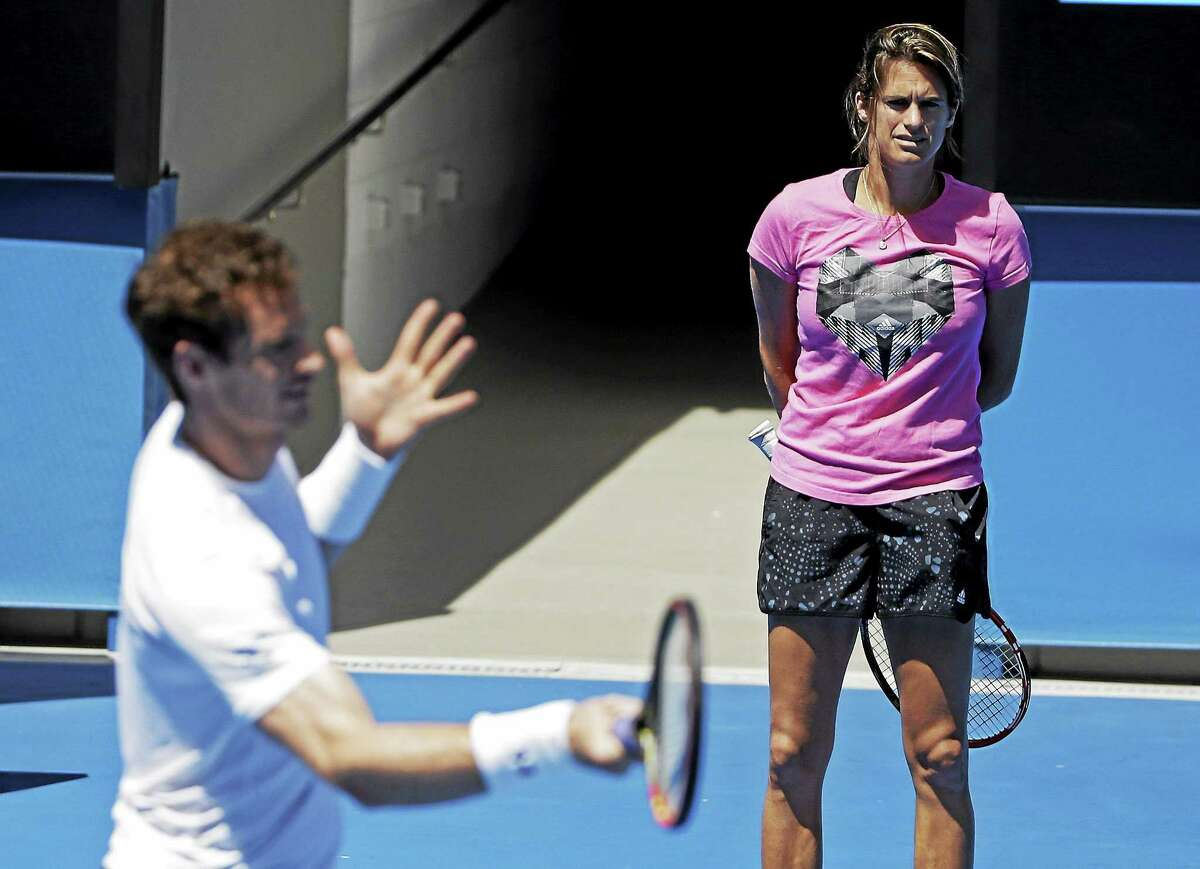 Andy Murray practices as his coach, Amelie Mauresmo, looks on ahead of the men's singles final at the Australian Open in January.