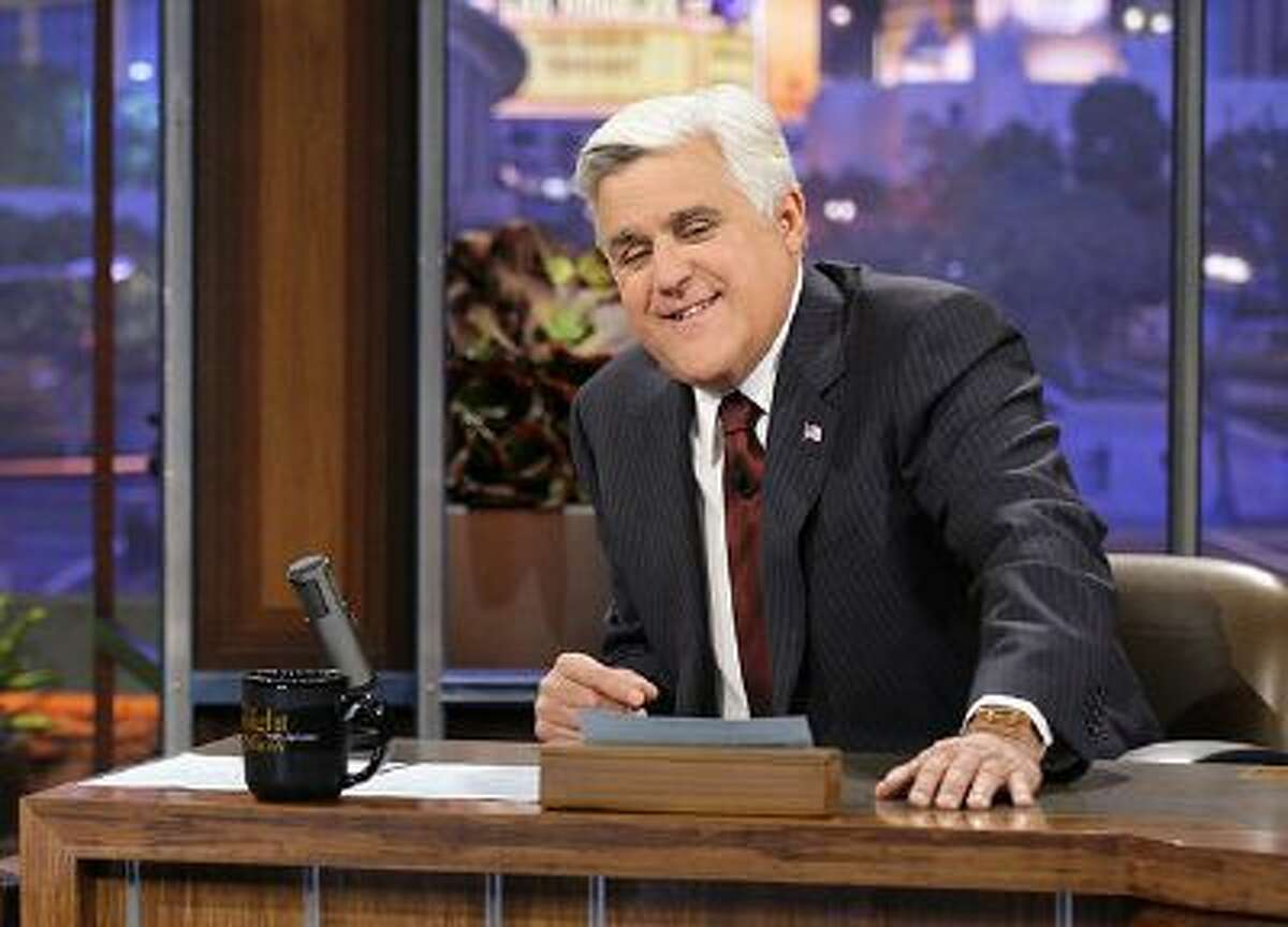 """This Nov. 5, 2012 photo released by NBC shows Jay Leno, host of """"The Tonight Show with Jay Leno,"""" on the set in Burbank, Calif. During Leno's two-decade tenure as NBC's """"Tonight"""" show host, the comic has cracked a total of 4,607 jokes at the expense of President Bill Clinton. The Washington-based Center for Media and Public Affairs counted and catalogued nearly 44,000 jokes Leno made about politics and public affairs during his time at """"Tonight,"""" which ends Thursday."""