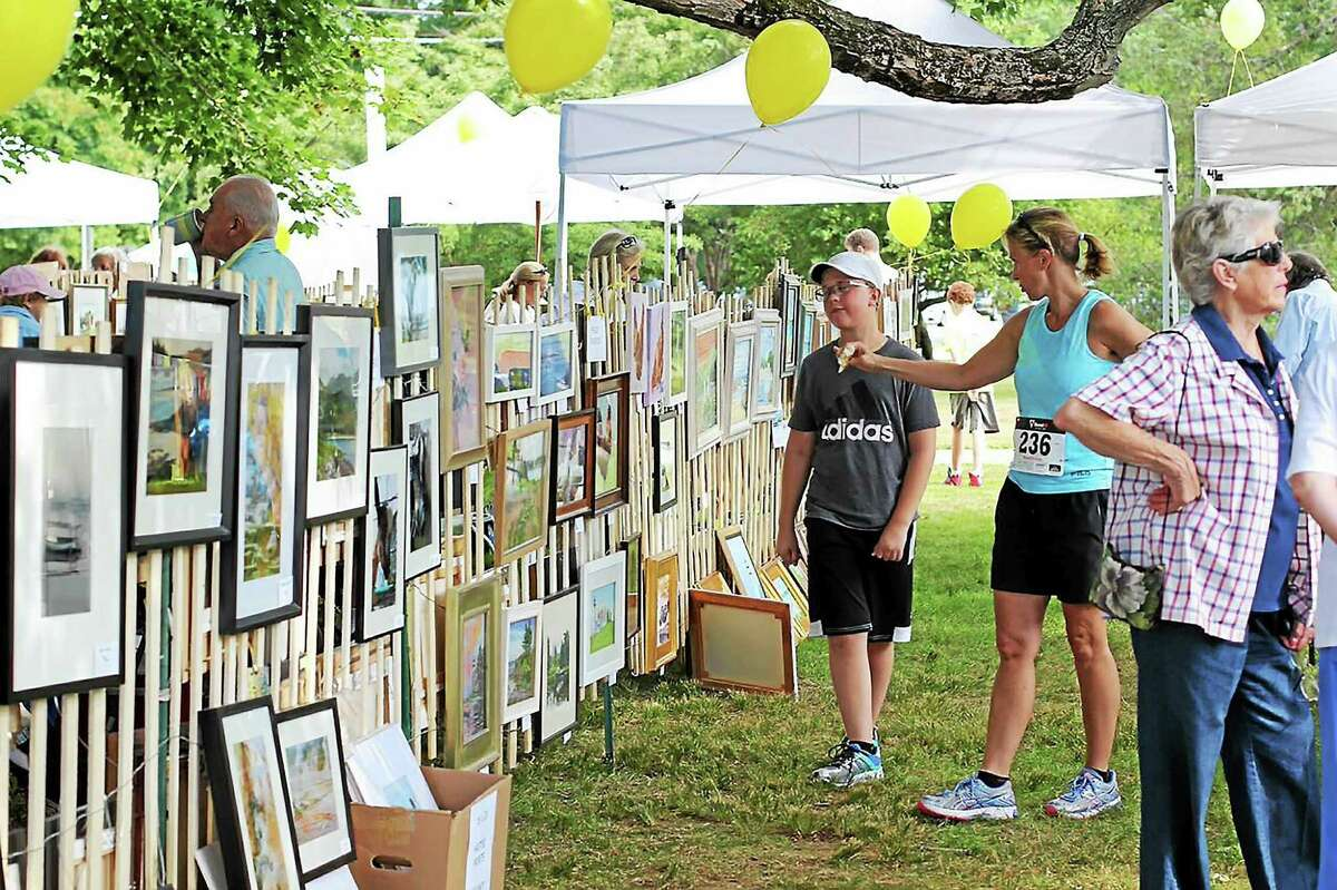 Contributed photos Local plein air artists ìon the fenceî at the Center School lawn in Old Lyme, demonstrate their mediums, including watercolor, acrylic, oil, and pastel.