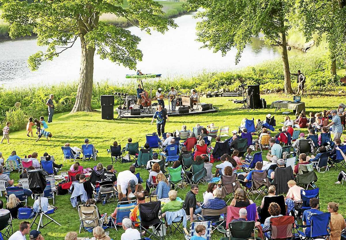 Contributed photos Guests at last year's Midsummer Festival in Old Lyme relax by the river at the Florence Griswold Museum. This year, festival guests can enjoy an evening of American music by Manhattan Brass from 7-9 p.m.