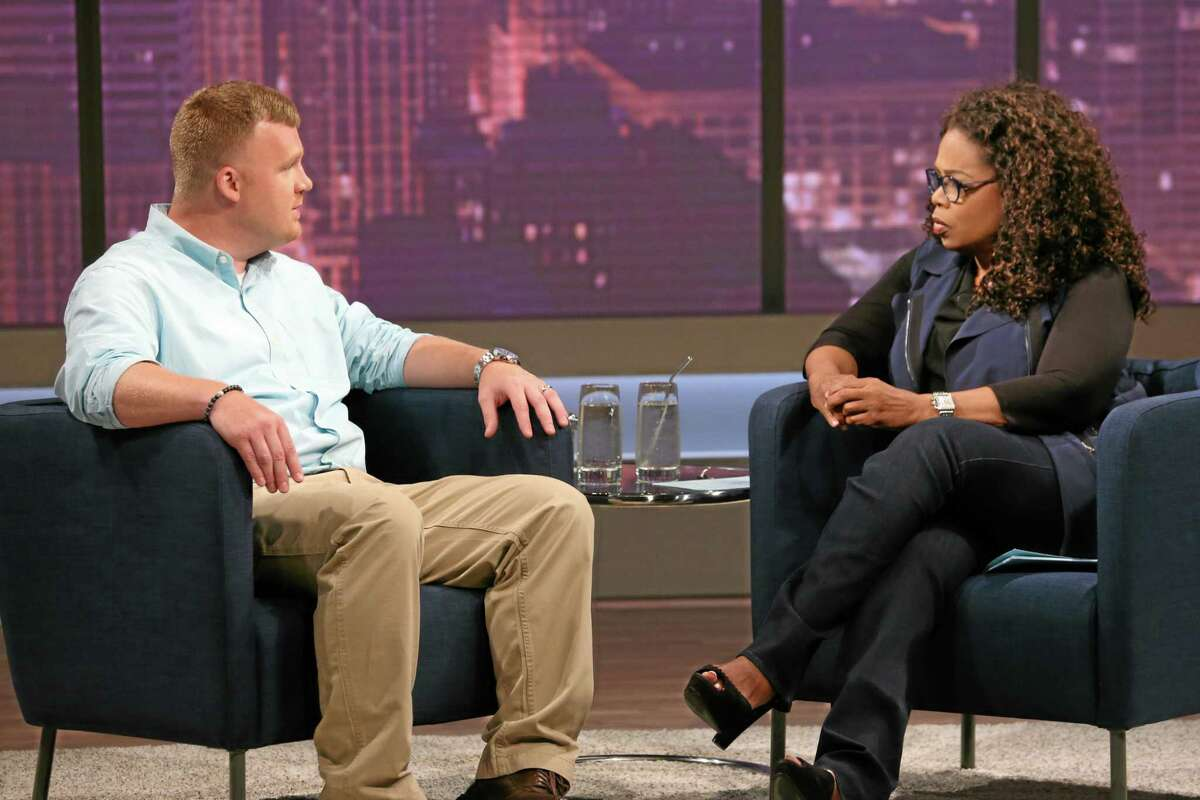 This June 27, 2014 image released by OWN shows Matt Sandusky, the adopted son of former Penn State University assistant football coach Jerry Sandusky, during an interview with Oprah Winfrey, airing on OWN on Thursday, July 17. Matt Sandusky says he enjoyed spending time with the family at their central Pennsylvania home _ except when it came time to go to bed. The Oprah Winfrey Network on Wednesday, July 16, released a clip of Winfreyís interview with Matt Sandusky, who alleges he was sexually abused by his father. (AP Photo/Harpo, Inc., George Burns) MANDATORY CREDIT: GEORGE BURNS