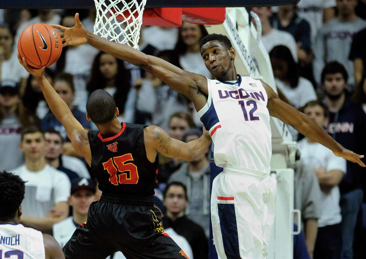 UConn's Kentan Facey defends Tampa's Pat Beacon during Sunday's exhibition game in Storrs.