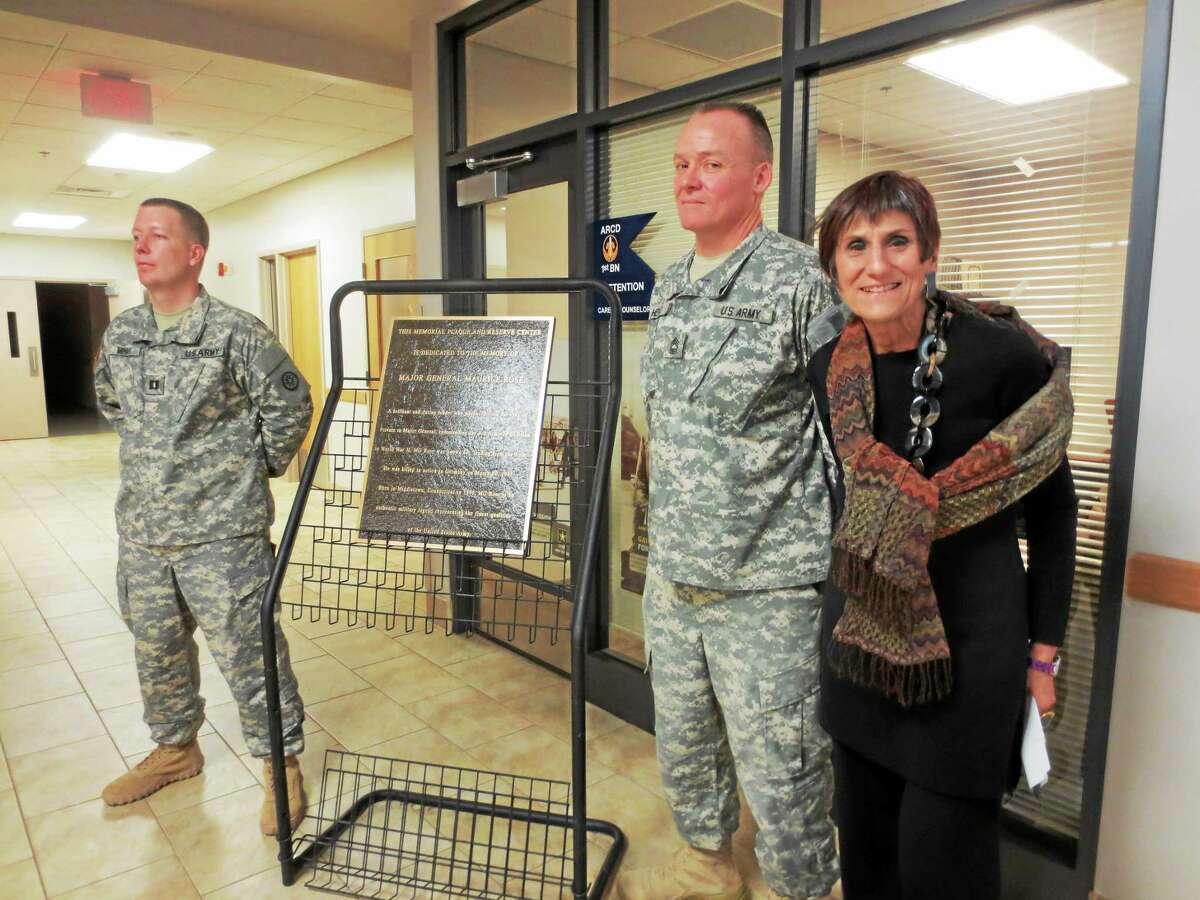 U.S. Rep. Rosa DeLauro is shown unveiling the plaque in honor of Major General Rose at the new Major General Maurice Rose Armed Forces Reserve Center in Middletown.